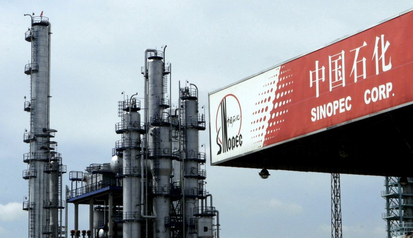 A Sinopec gas station besides oil refinery facilities of Sinopec in Pudong of Shanghai, China on 23 February 2006.     (Photo by Kevin Lee/Bloomberg News)