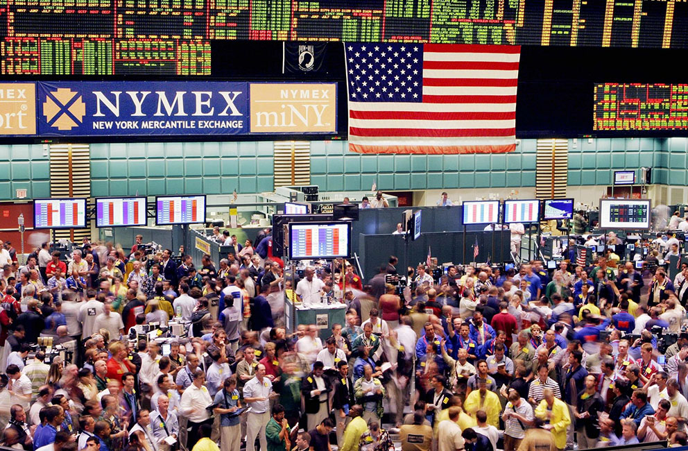 Traders on the floor of the New York Mercantile Exchange deal in crude oil futures Wednesday, Aug. 2, 2006. Crude oil and gasoline prices rose sharply Wednesday after a government report showed that U.S. crude and gasoline inventories fell last week, and as a tropical storm gained strength in the Caribbean. (AP Photo/Mark Lennihan)